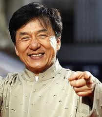 Jackie Chan points and smiles