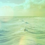 Lonely person floating in the ocean with waves