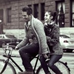 Couple riding bicycle and dating
