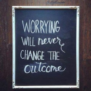 "Chalkboard with writing that says: ""Worrying will never change the outcome""."